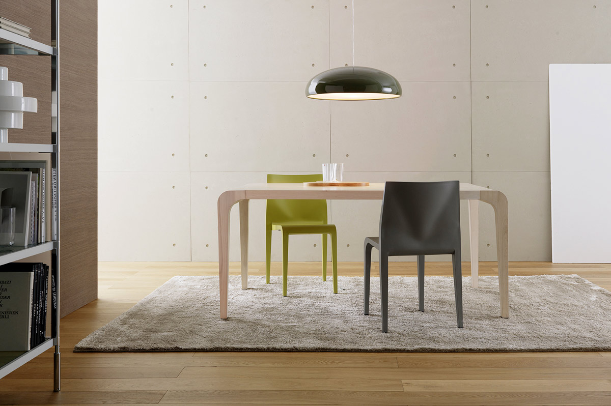 Lightness and technological innovation are the principles which shape this successful collection. It includes various elements, from the table to the stool, with a frame in wood with inner suppo...