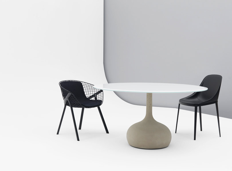 Saen reinterprets the table with central leg using a pliable material such as cement, which allows to create plastic and fluid shapes. Cement, typically used in architecture, is here applied to...