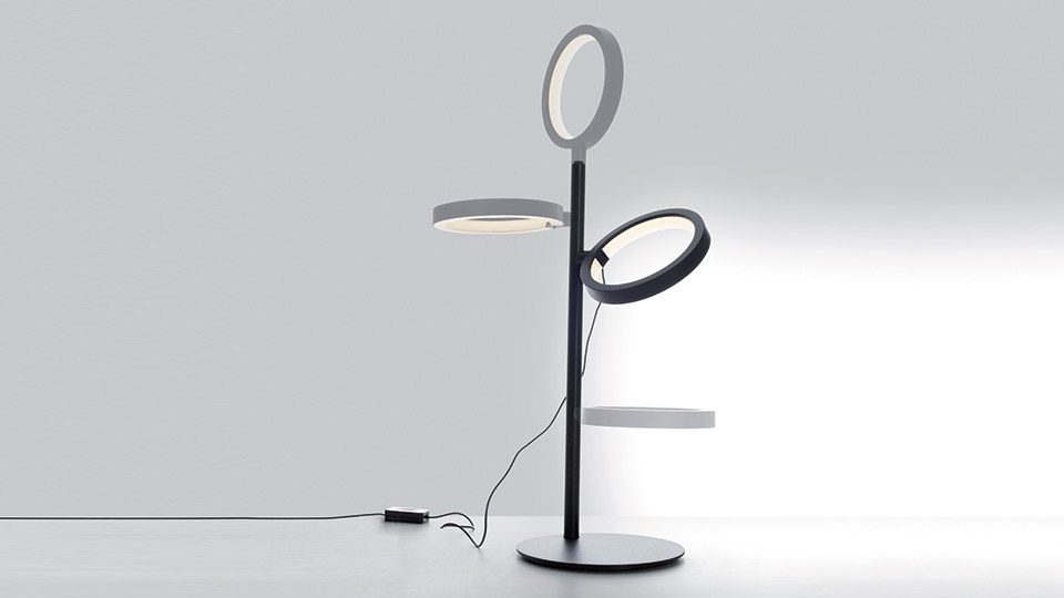 Ipparco is a lamp which combines a minimalist aesthetic with technology.  The ring can rotate 360° and is fitted with a magnet which allows you to attach the piece anywhere on the stem, either...