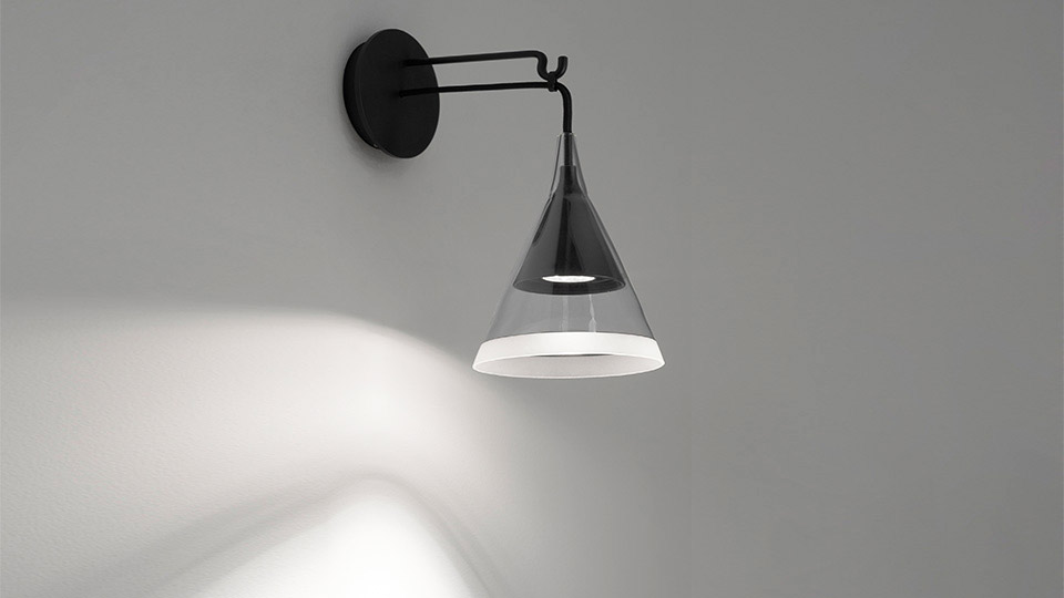 Designed by David Chipperfield, Virgo lamp has a retro feel and is available in either floor, pendant or wall-mounted version. The conical diffuser plays with different colours and materials:...