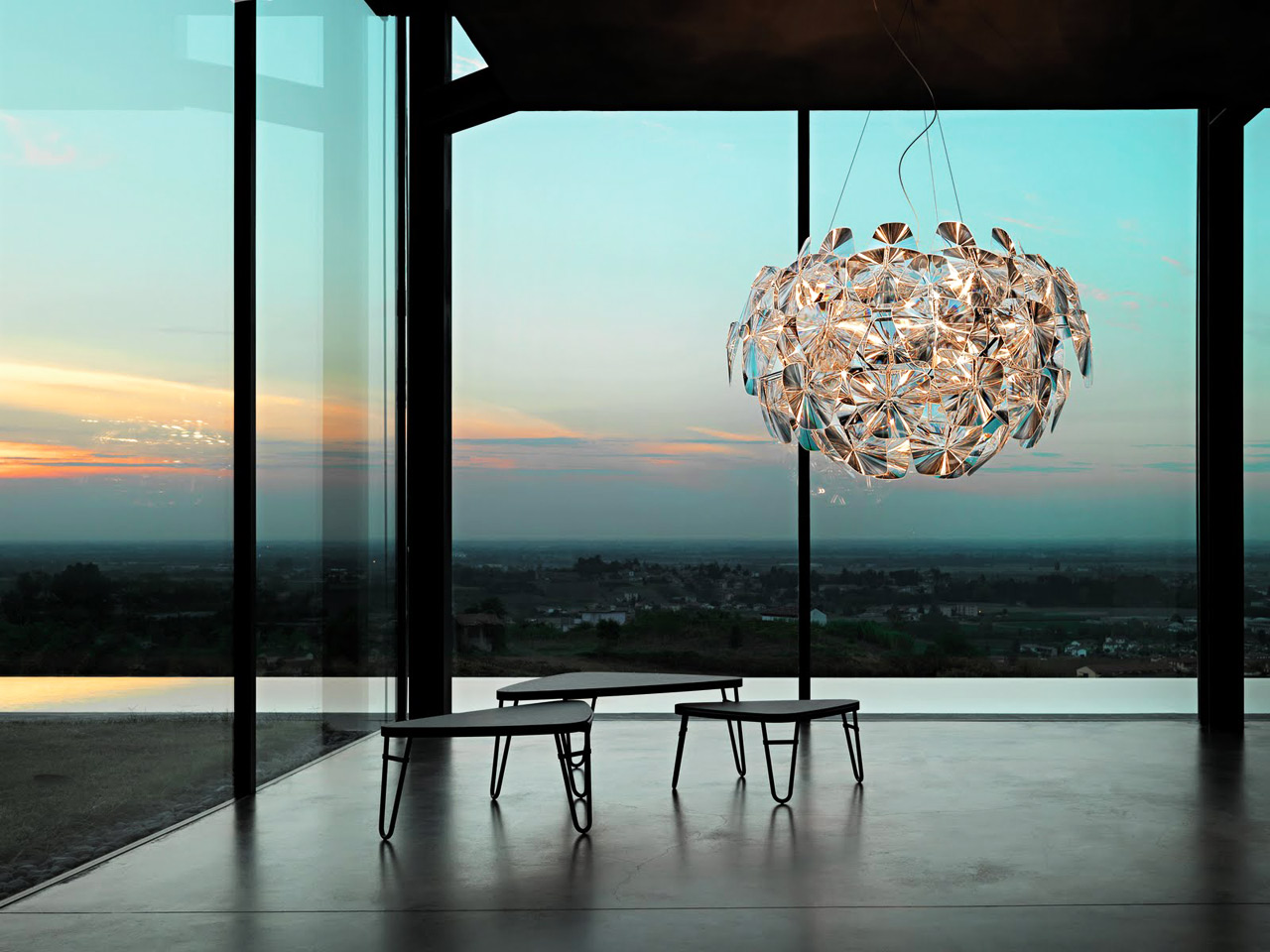 Hope reinterprets the archetype of traditional pendant lamps integrating innovative materials. It is made of Fresnel lenses (polycarbonate film) for a lightweight and glittering product. It was...