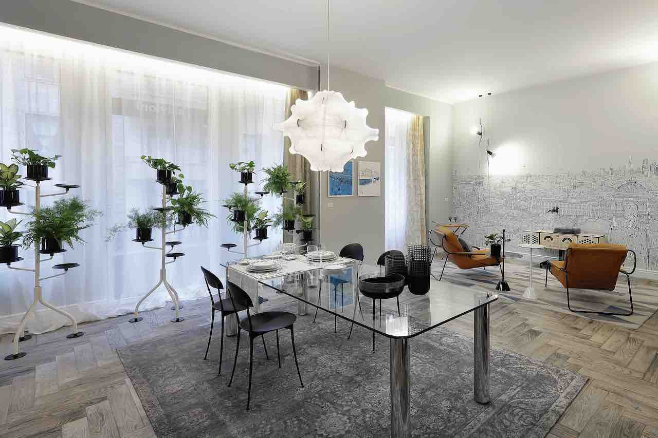 The dining area of the living with Marcuso table and Tonietta chairs by Zanotta. Lighting by Flos