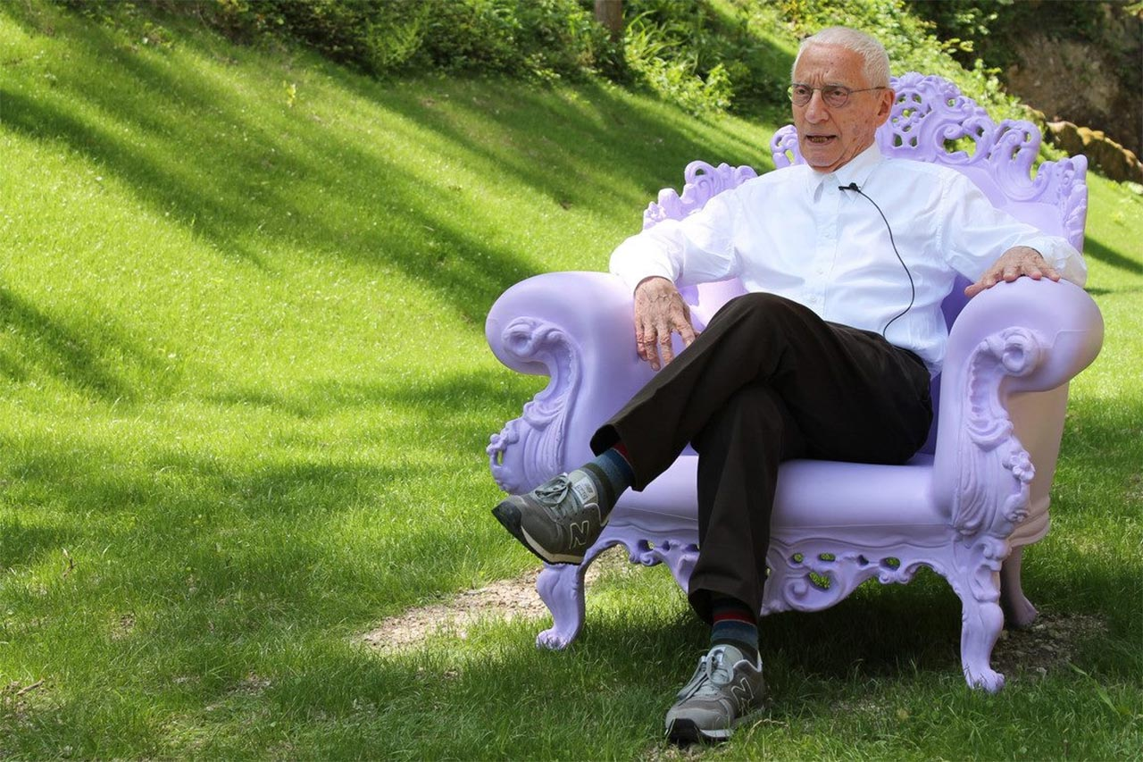 Alessandro Mendini designer sitting on his Proust armchair