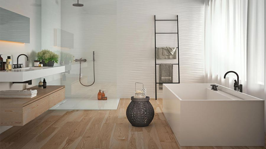 A bathroom defined by sharp shapes and light