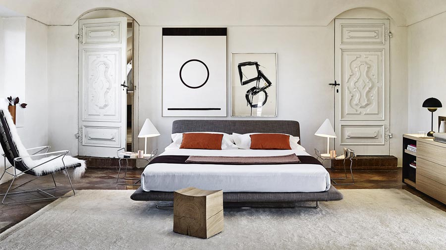 A bedroom that combines traditional and modern pieces