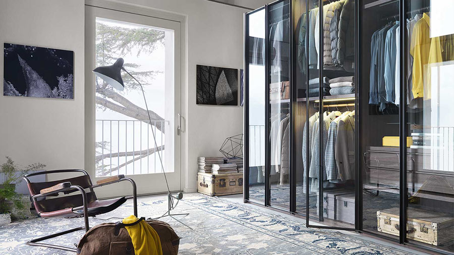A bedroom with an exposed closet