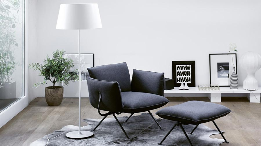 Grey armchair+white lamp: a cosy snug in urban-style