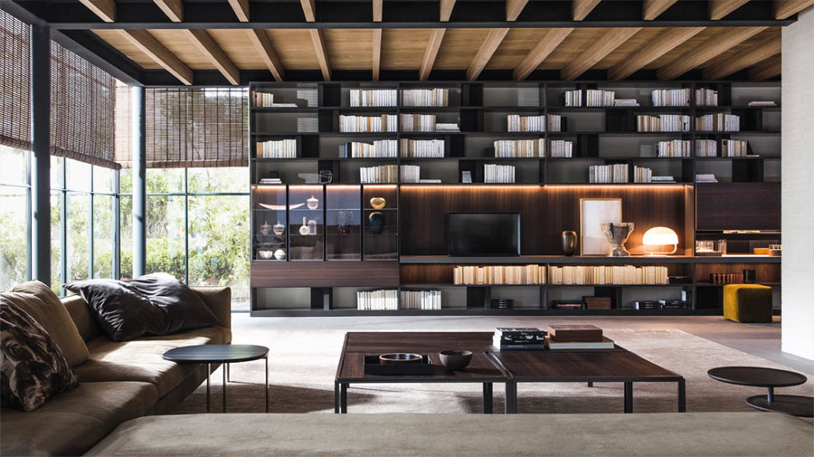 A living room with extra-large sofas and bookcase