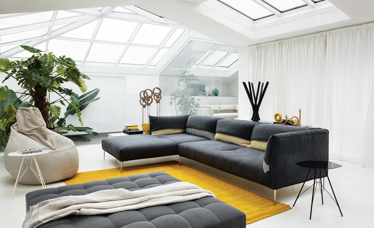 In this modern living room, elegance comes in grey and yellow
