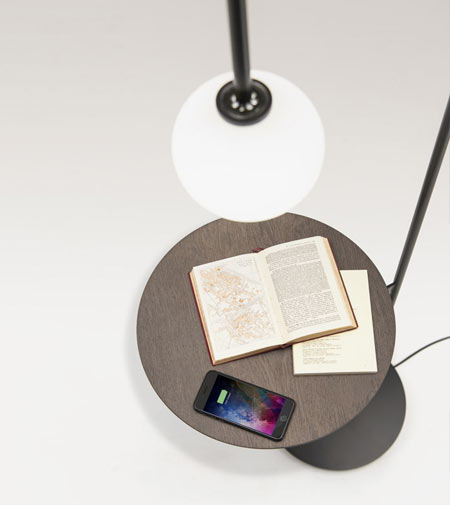 Light with a table by Living Divani, a coffee table with a poetic feel