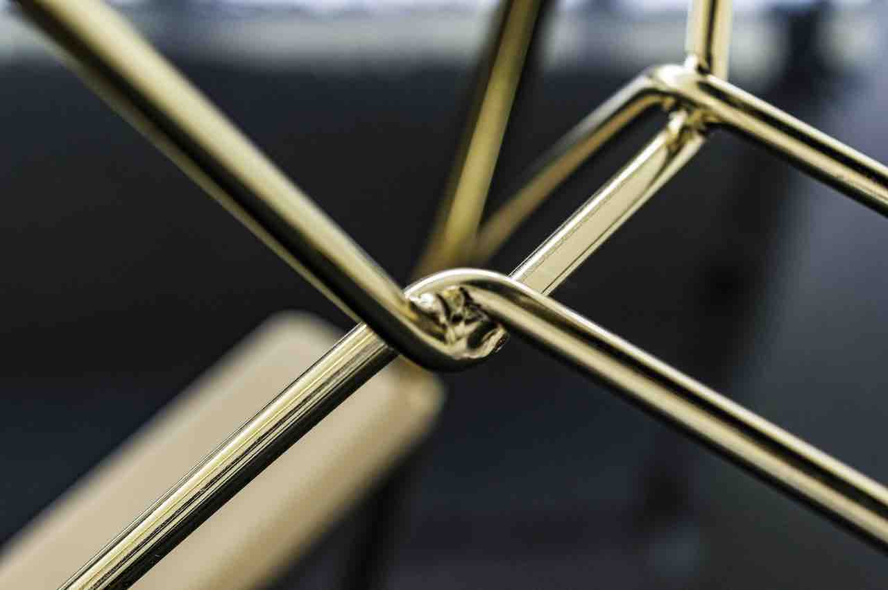 A detail of the golden steel structure. Troy stool, design Marcel Wanders, Magis 2018.