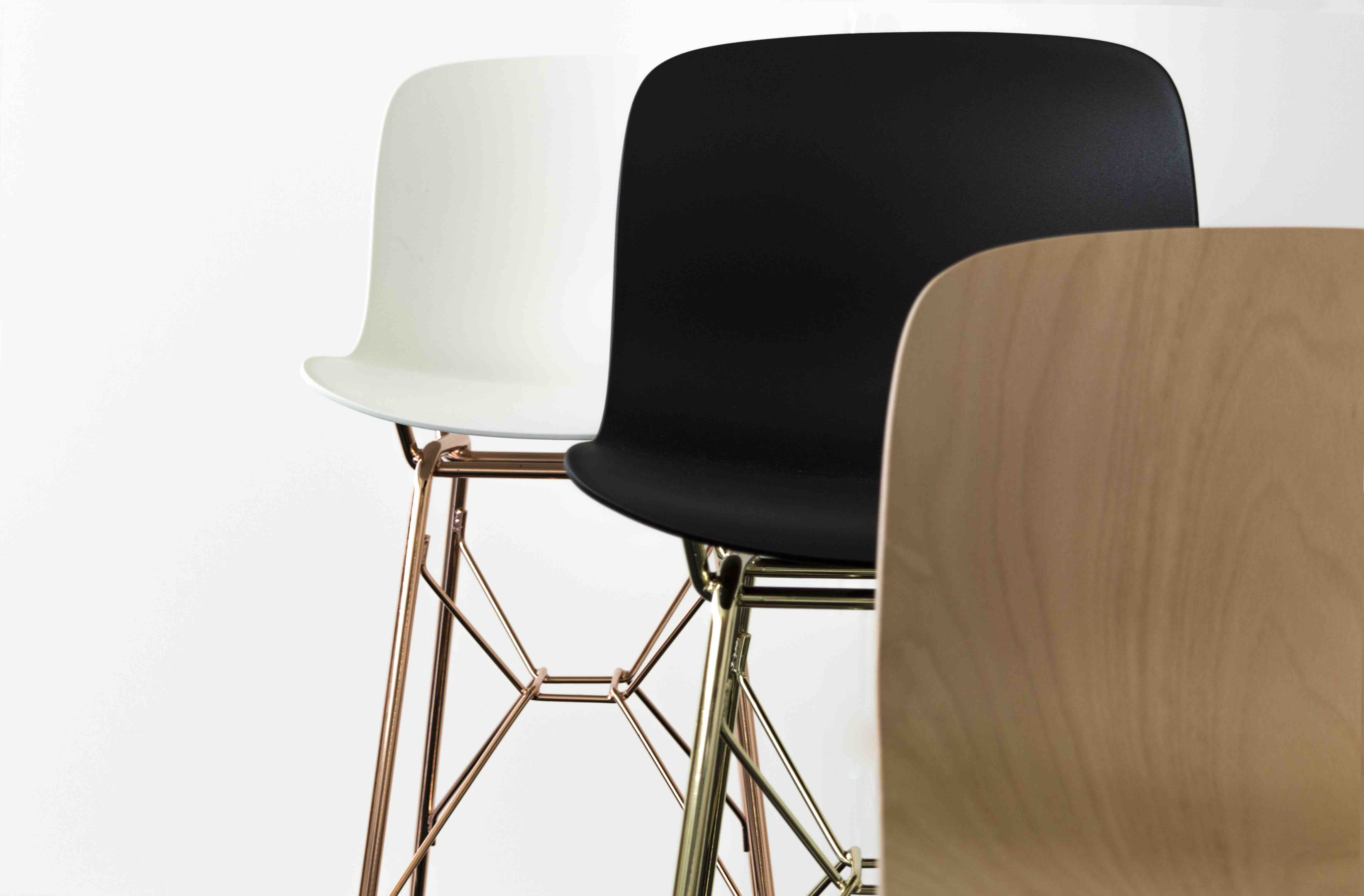 The seat of the Troy stool in a choice of white or black polypropylene as well as beech plywood.