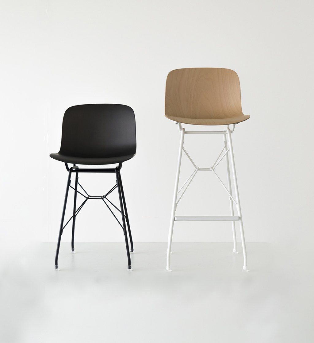 The Troy stool with the seat in black polypropylene and beech plywood, the structure is in white and black painted polyester.