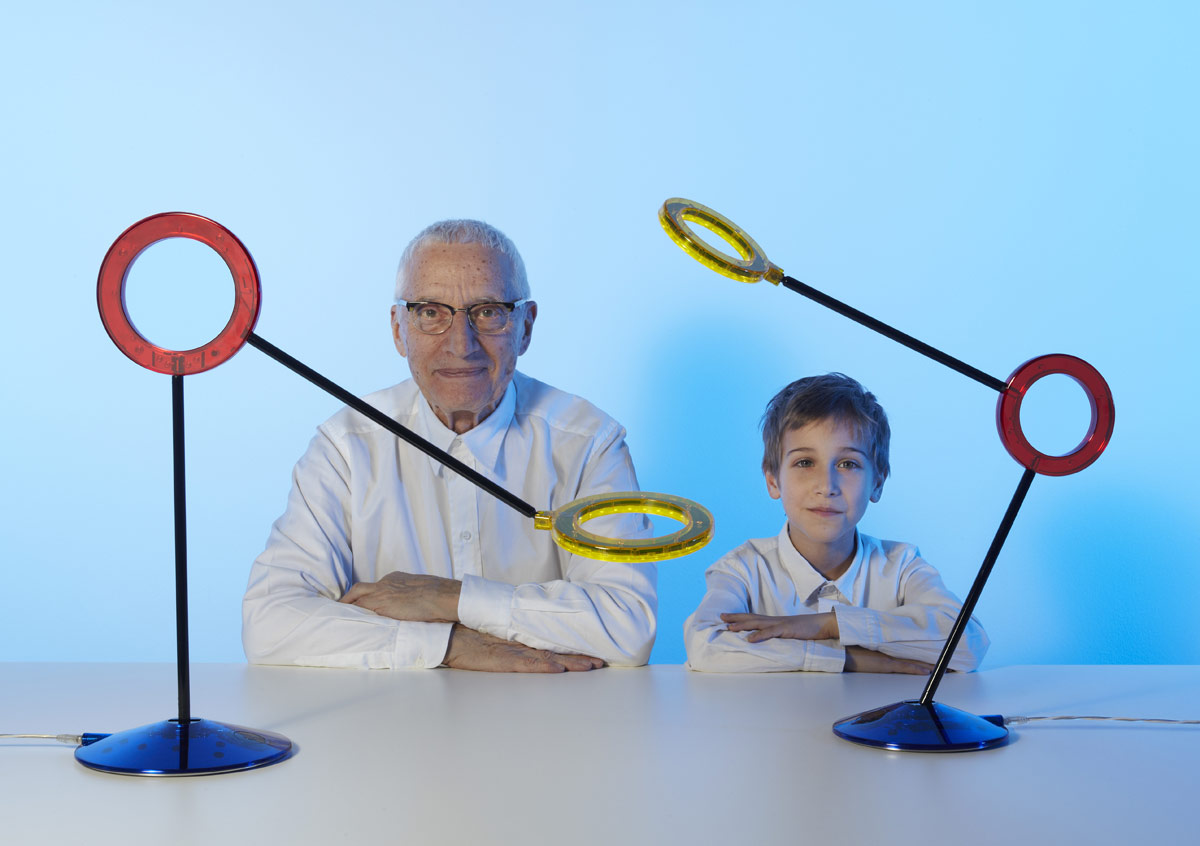 Alessandro Mendini with his grandson Tommaso and a table lamp (Photo Carlo Lavatori 2012)