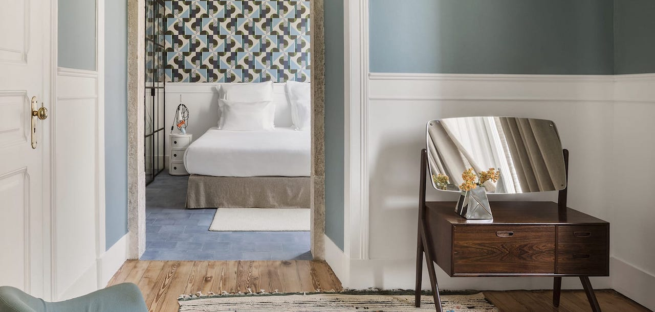 In every room, special details from the wallpaper to the wall colors and the boiserie.