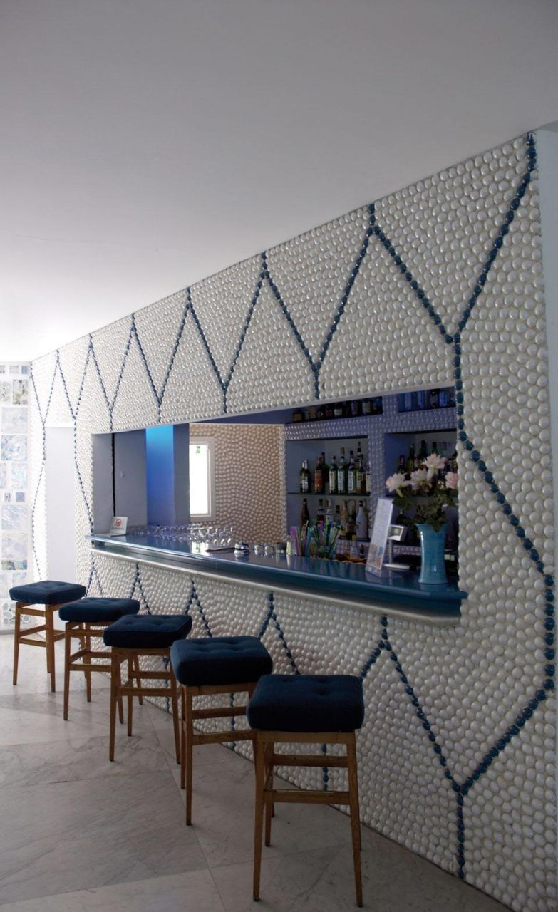 The bar with walls cladded in pebbles