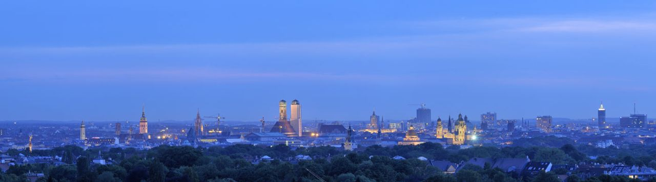 the Munich skyline with views across Bogenhausen and the riverside park.