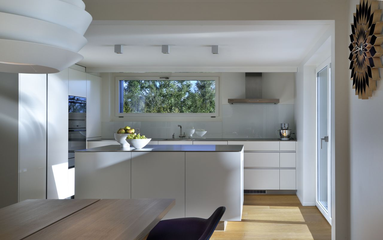 A bespoke minimalist kitchen in pure white; for a light and bright space.
