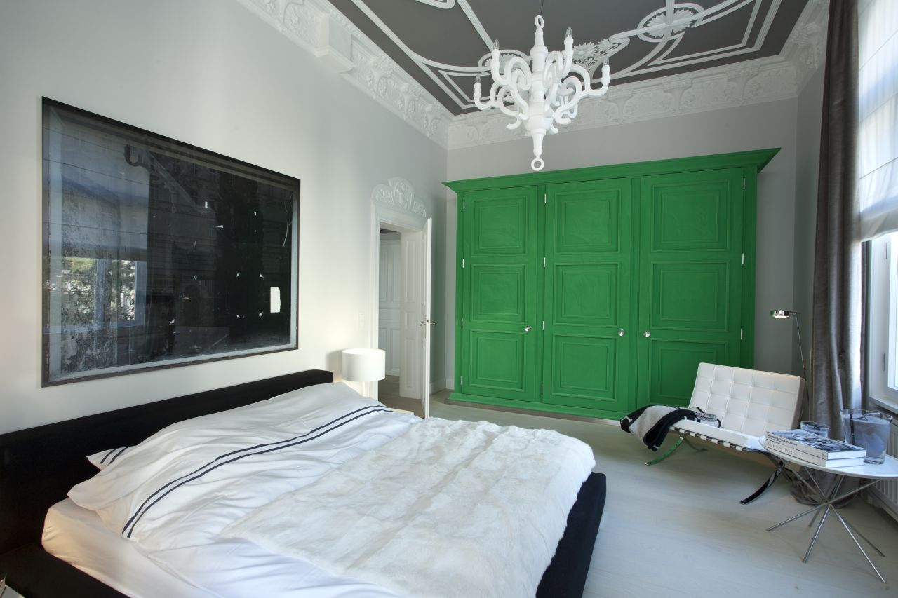 In the master bedroom a green lacquered wardrobe