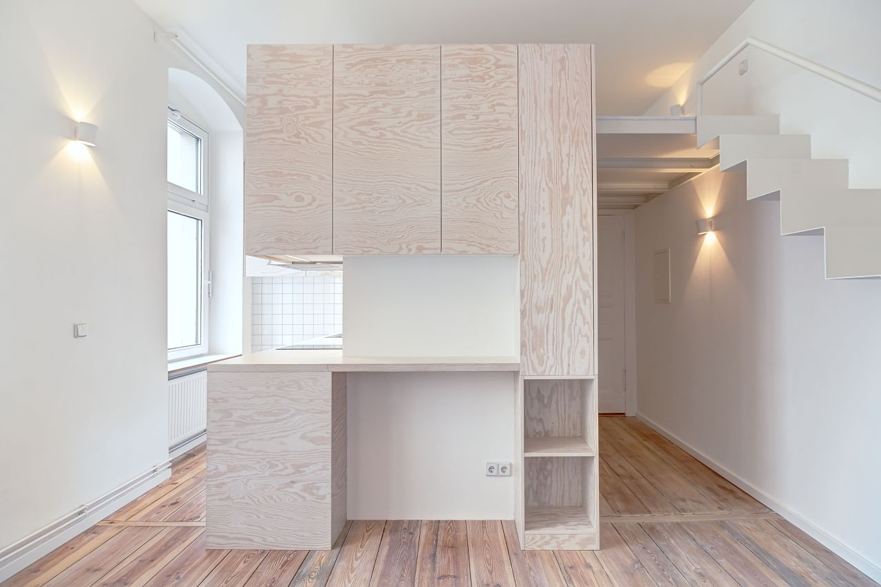 The 21 sqm studio apartment with its central service core, by Spamroom
