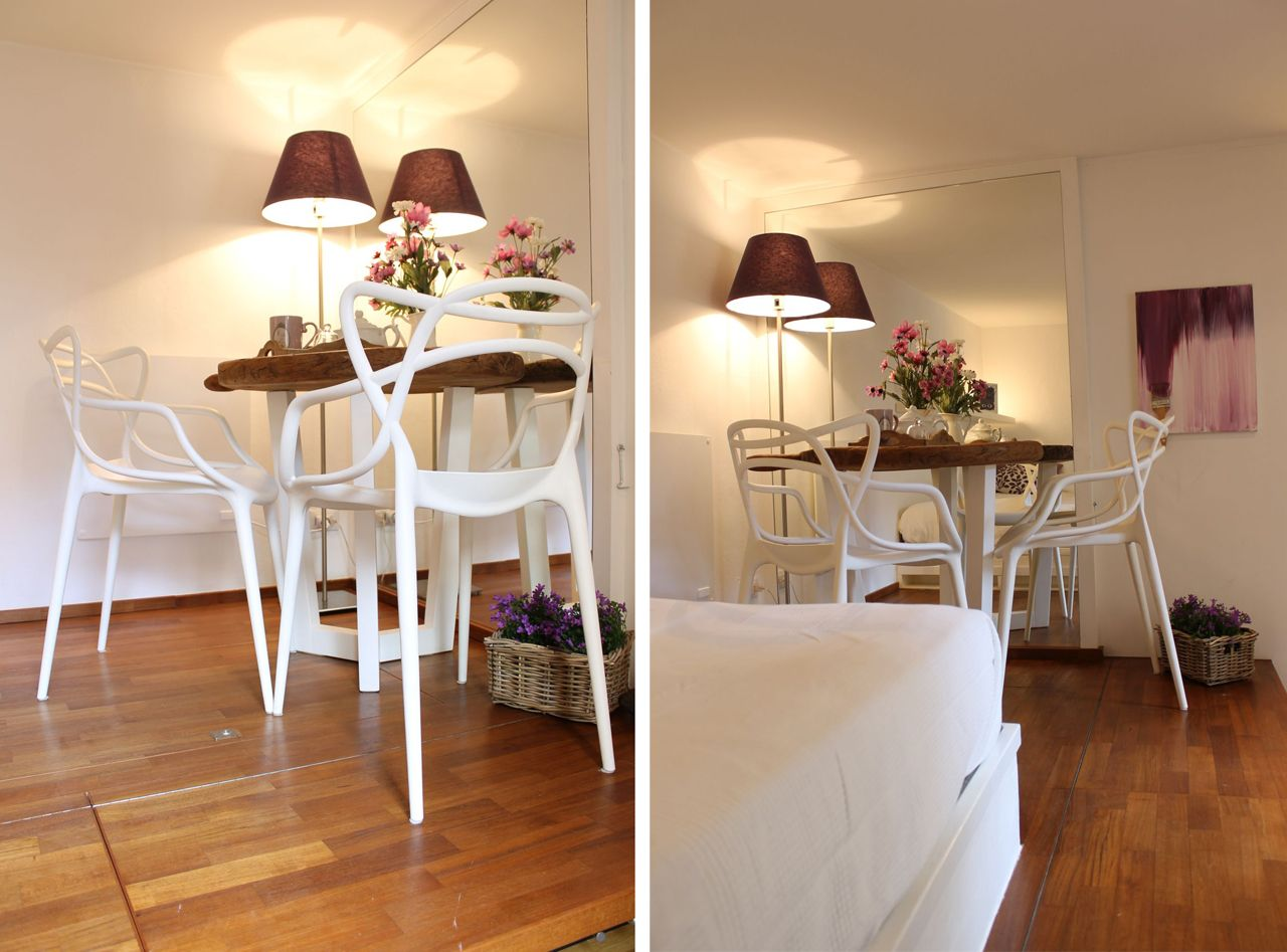 sA mirror makes the breakfast area feel larger. Tiny table and Masters chairs by Kartell