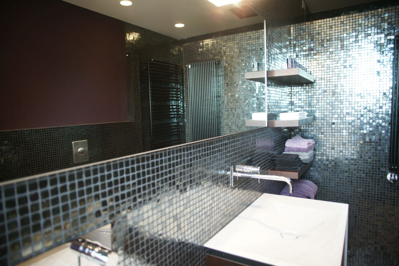 Glamorous bathrooms with shining mosaics (Sicis) and refined fixtures and fitting by Boffi.