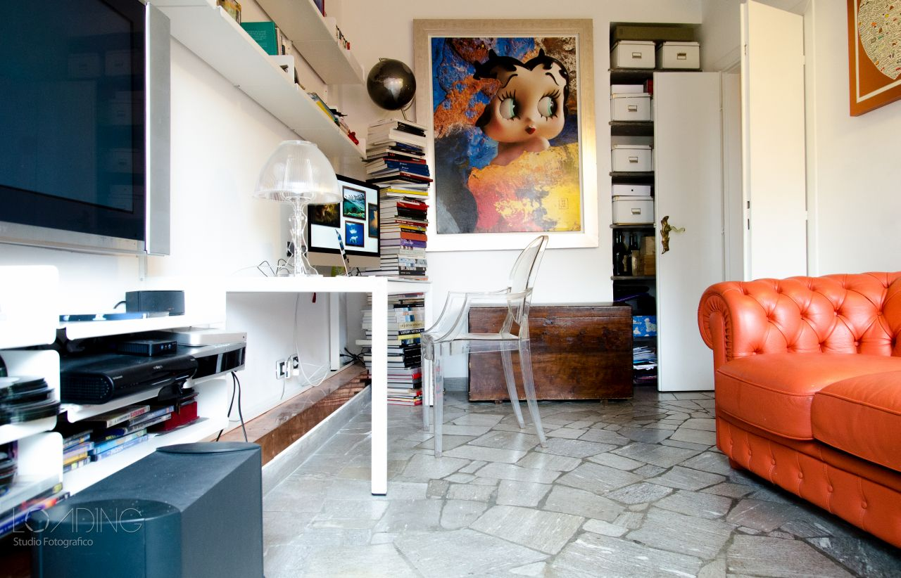 The old kitchen converted into a home office with TV area. Crazy paving in marble.