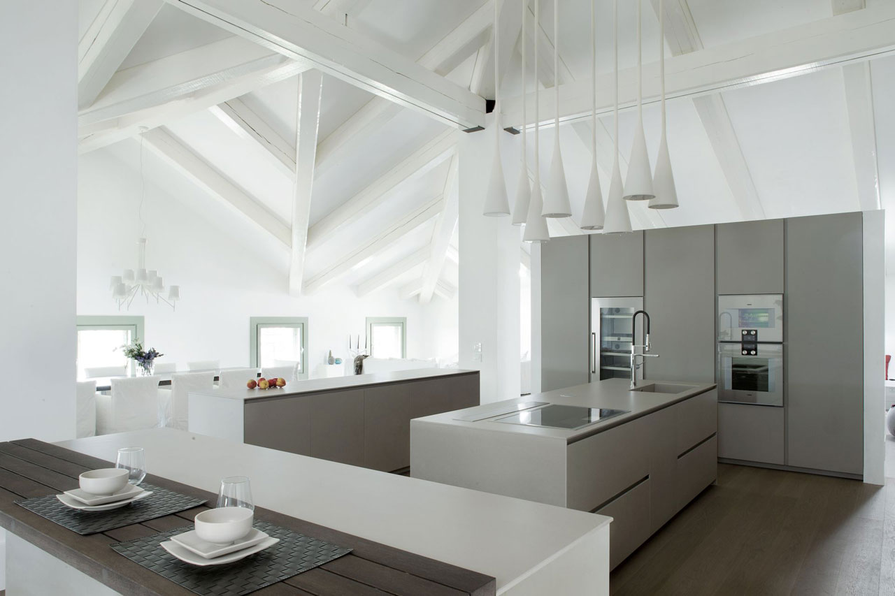 Minimalist storage units in the kitchen. Breakfast bar in the foreground. Photo: Courtesy Arredo Dal Pozzo.