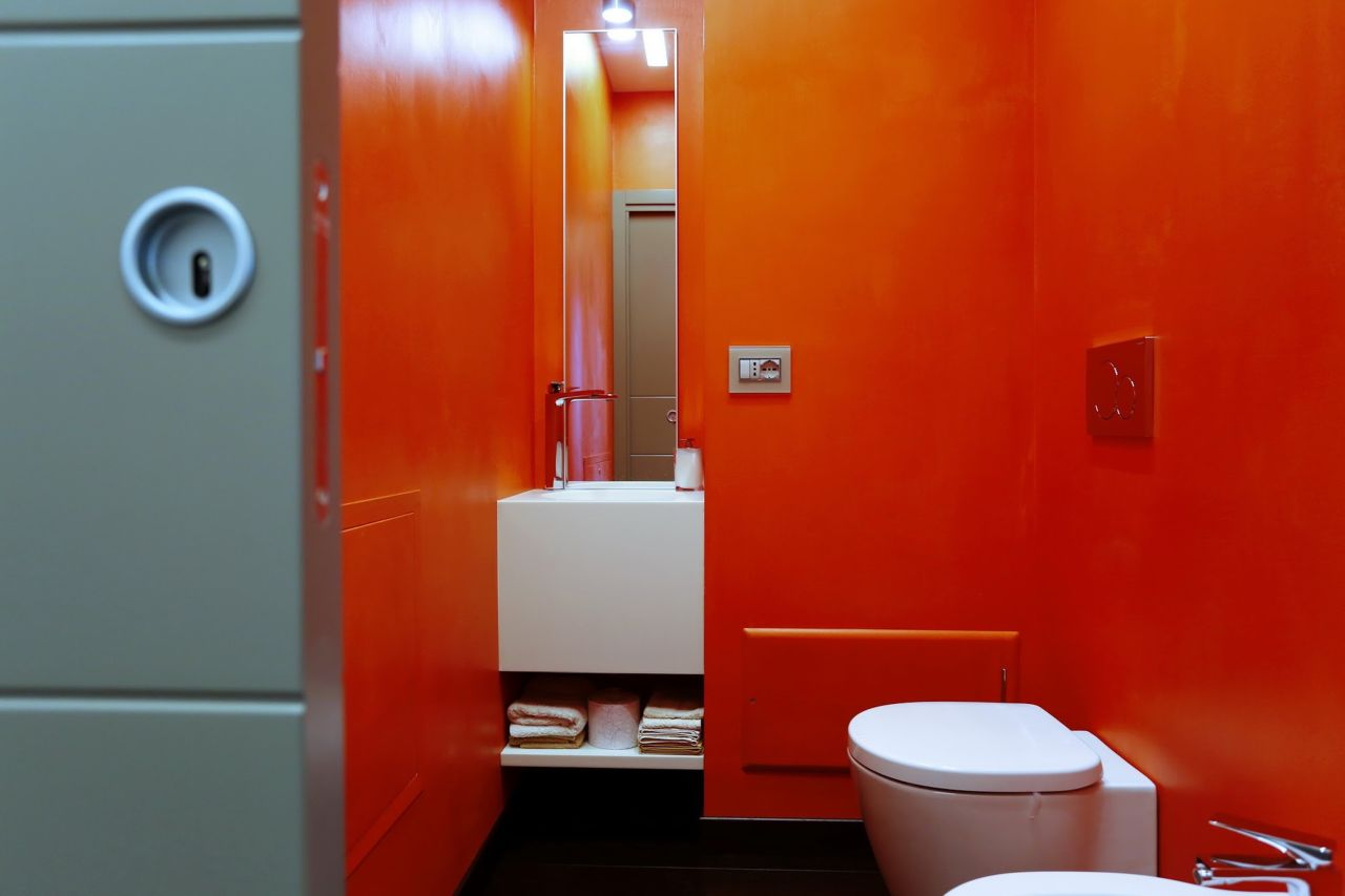 The guest toilet in red color