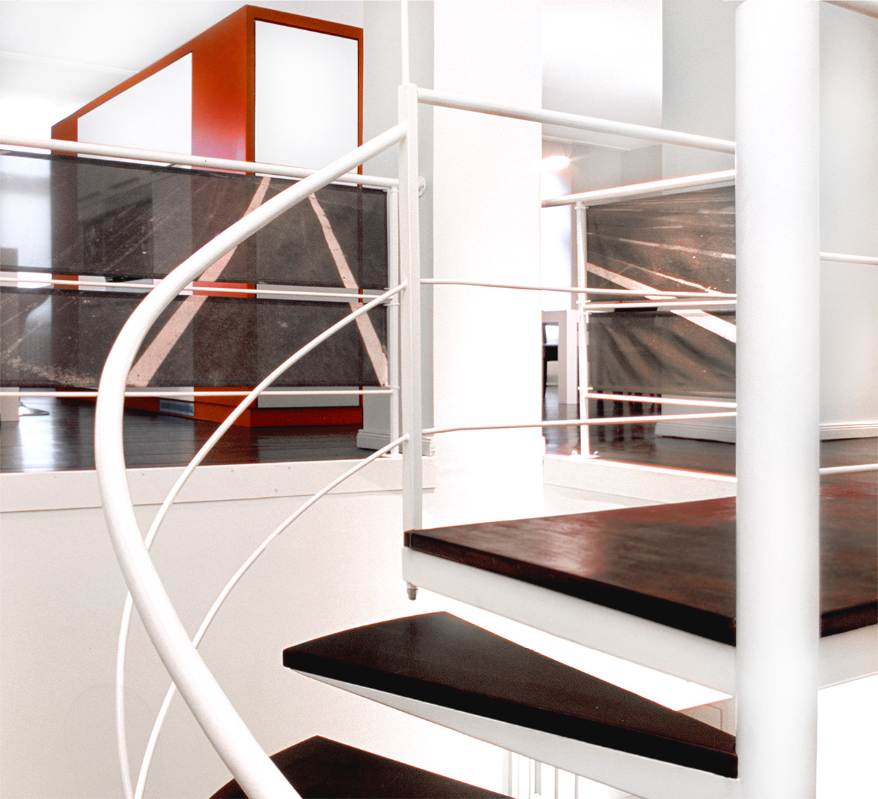 The bespoke spiral staircase; it leads from the entrance to the top floor, where kitchen and dining room are.