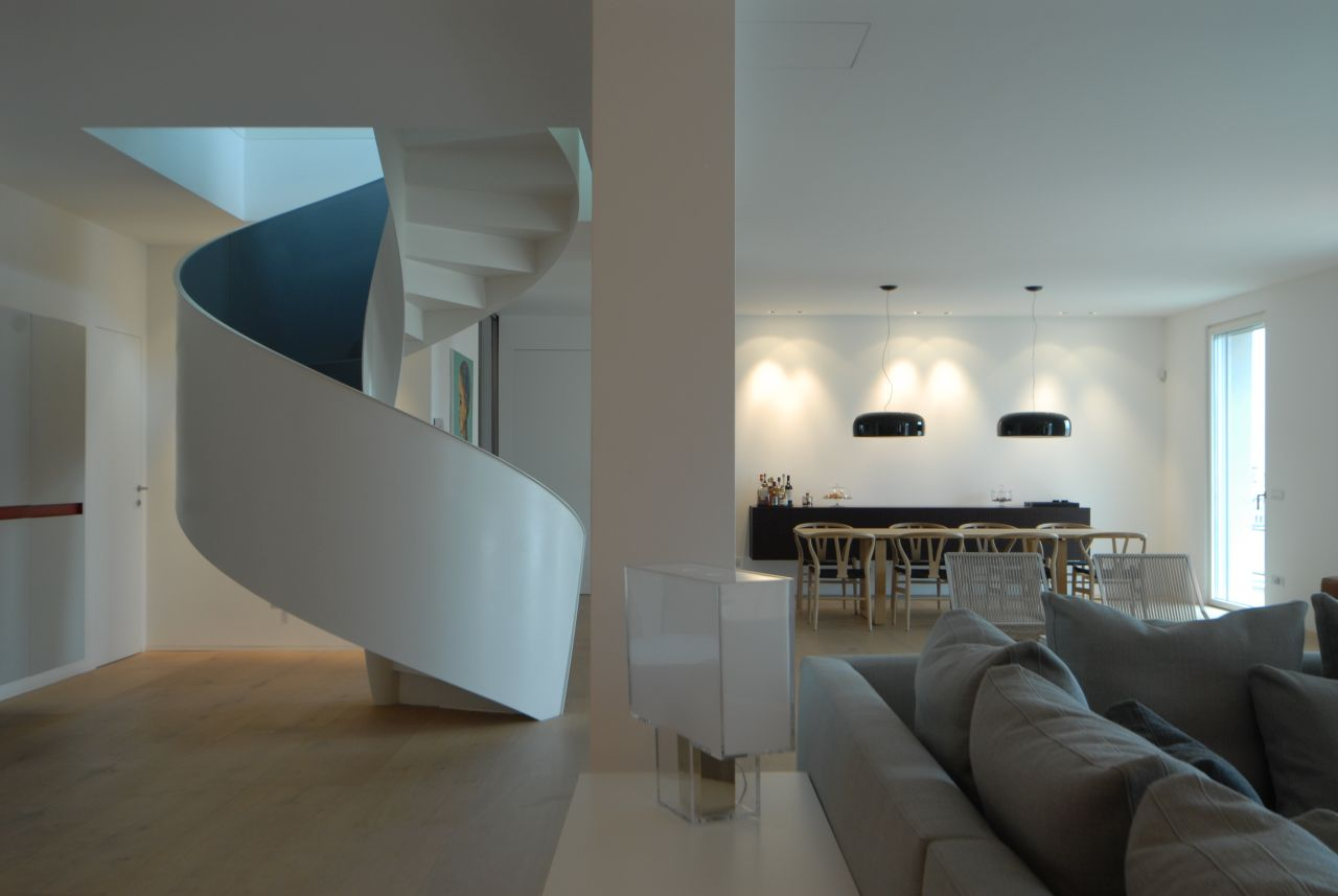 The staircase is right in the centre of the living room.