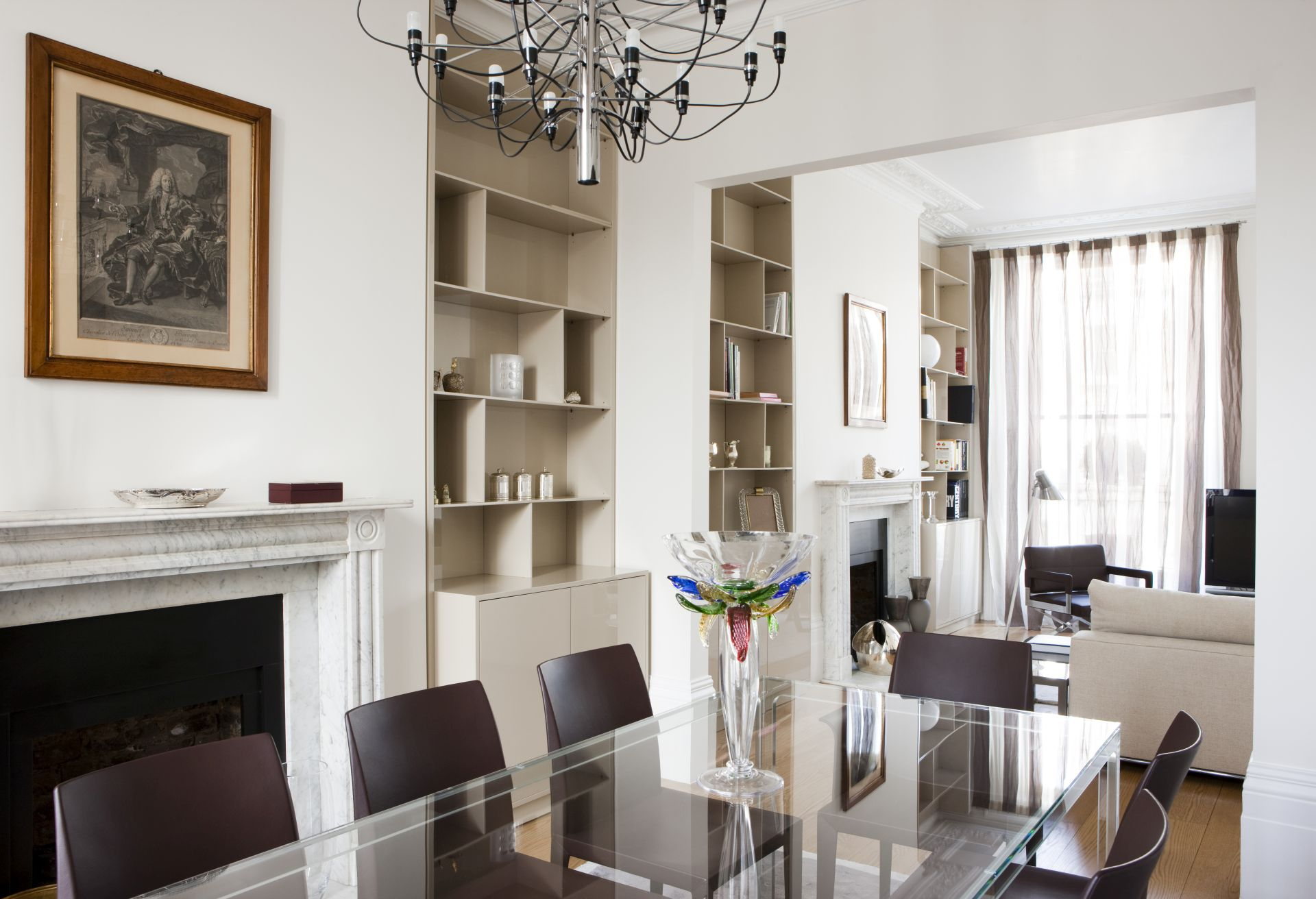 The recessed shelving in the alcoves beside both fireplaces is made to meausure by Italian carpetners.