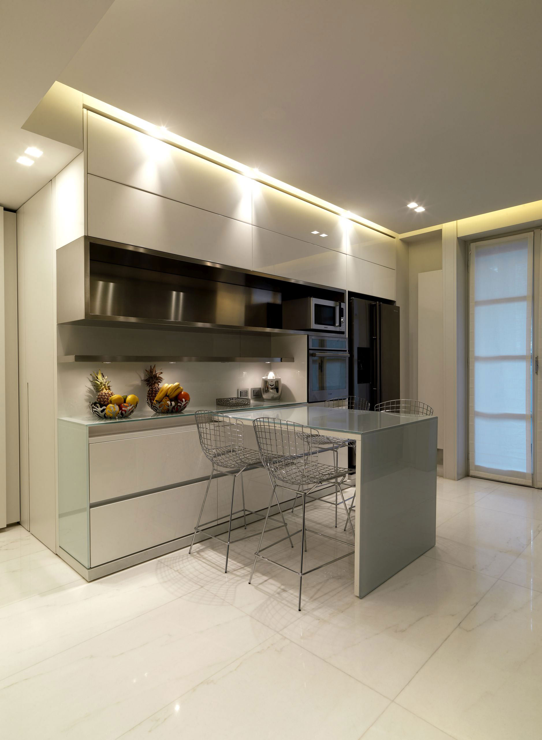 Bispoke minimalist kitchen by Pedini. French doors open onto the balcony at the back of the building.