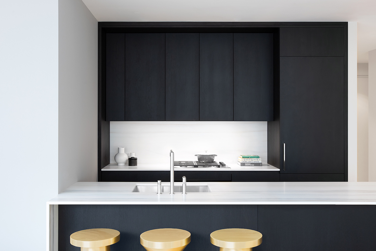 The Velvet Elite kitchen by GD Arredamenti is in 3-layer, solid oak in a brushed finish stained black