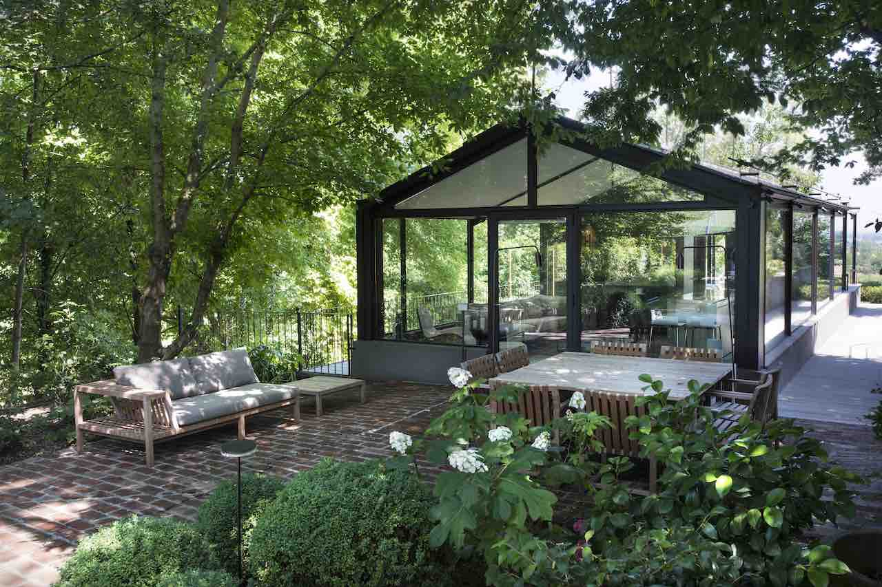 The Glass House from the entrance side with the outdoor living room/ dining area by Roda