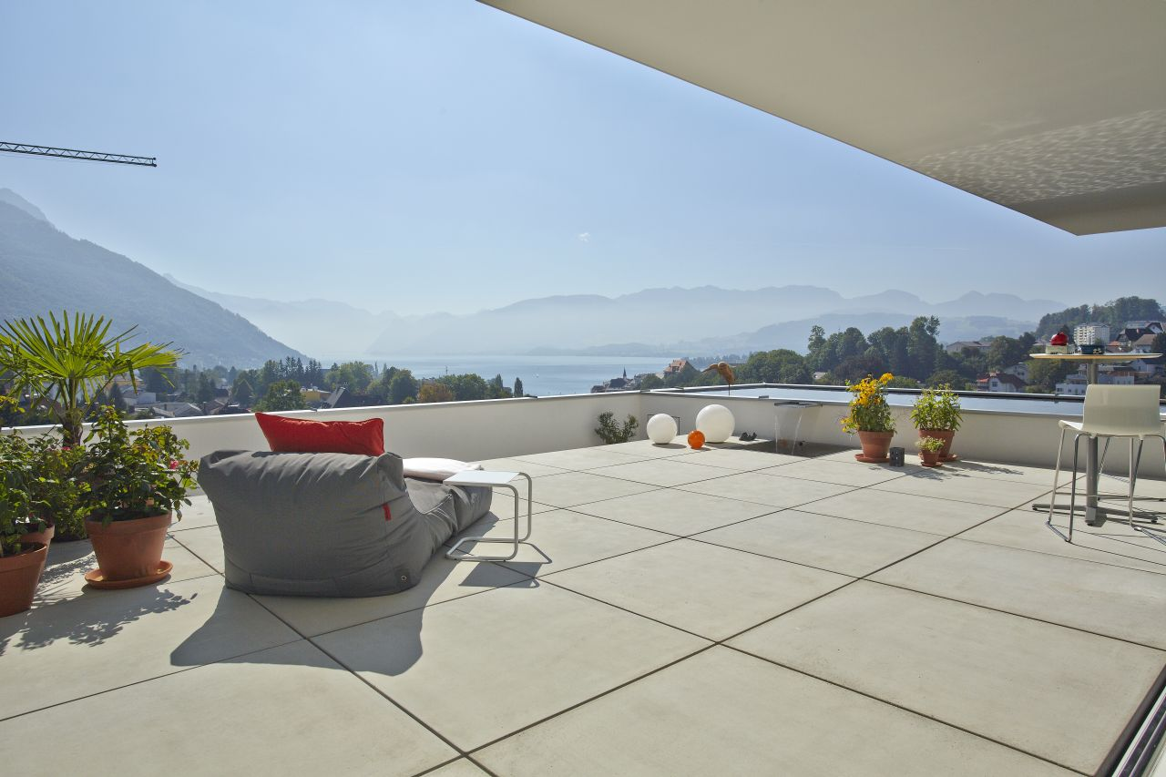 The large terrace overlooks the lake Traunsee in Austria