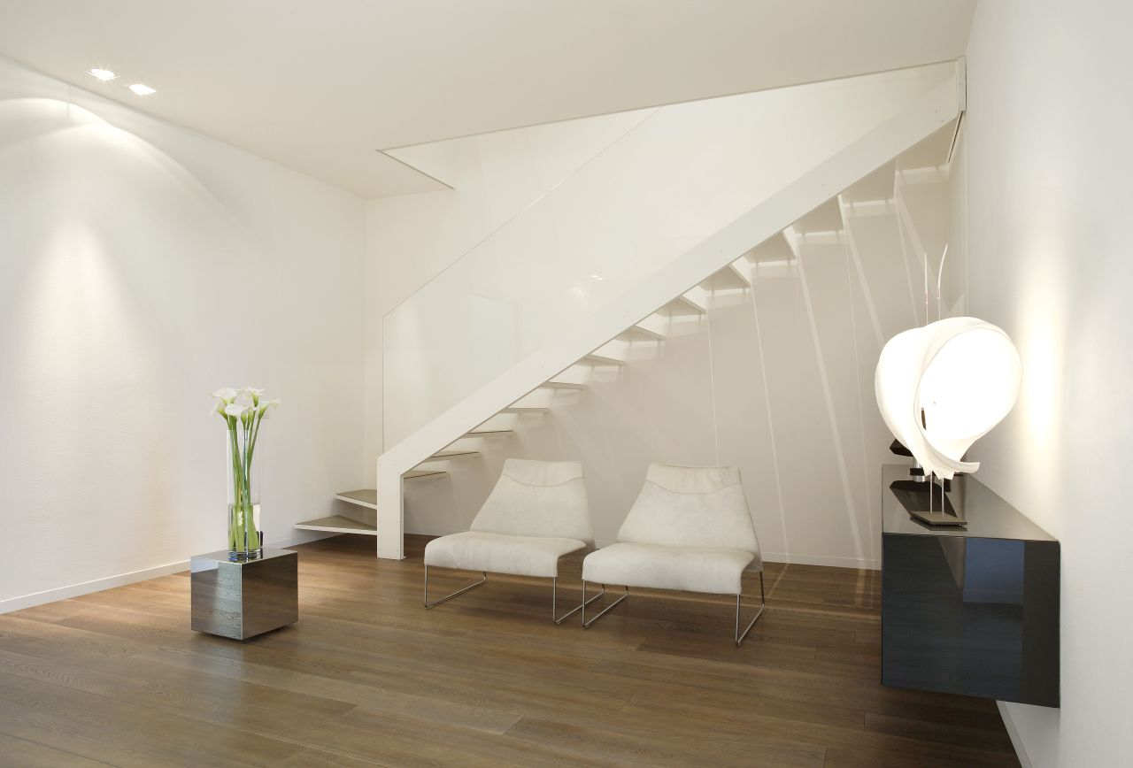White with occasional dark accents and slatted oak flooring feature in every room