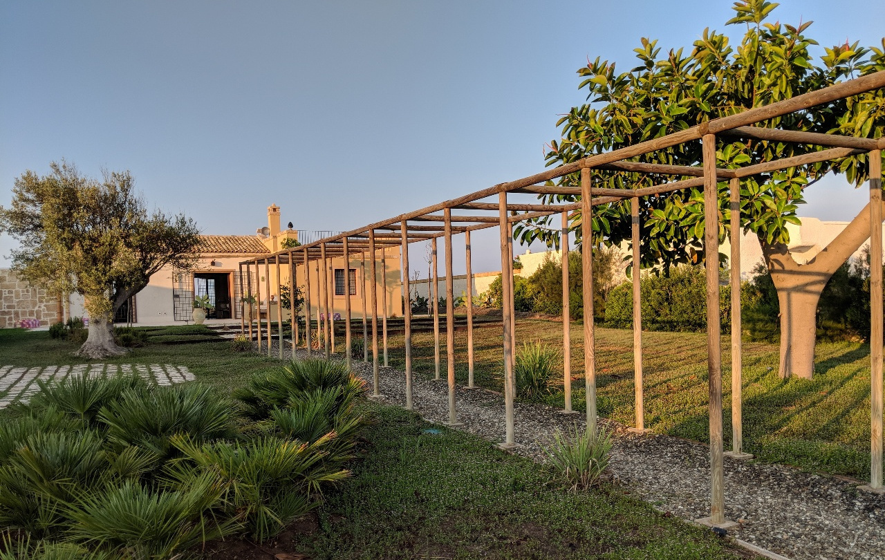 The long pergola that leads to the entrance of the house. Granelli, Sicily
