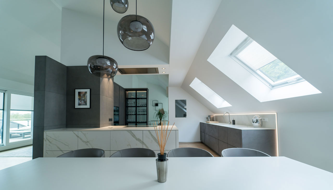 A light-filled penthouse: an exposed kitchen in Luxemburg