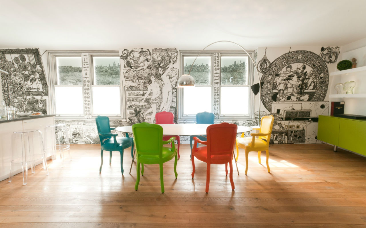 Boldly painted chairs in contrasting colours. Each member of this family has its own colour.