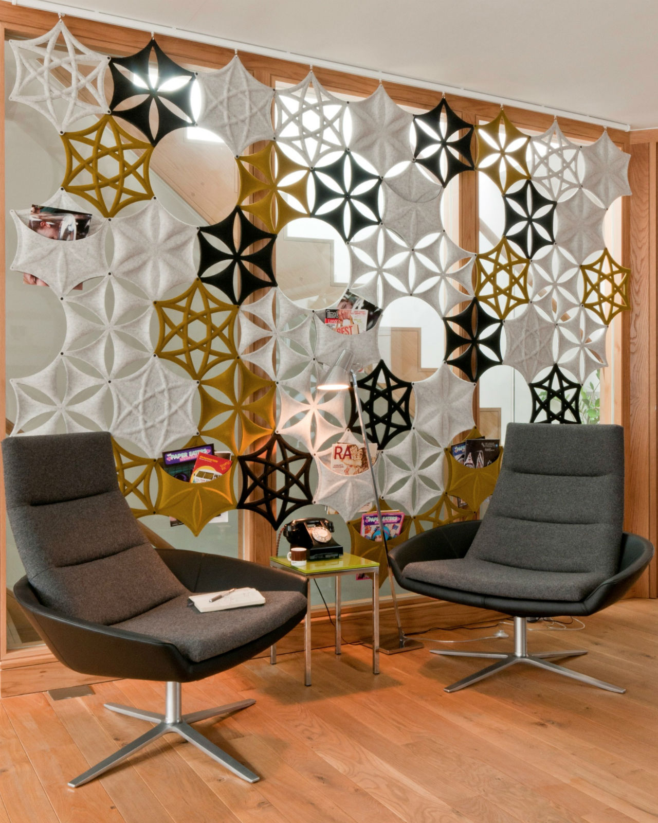 A geometric curtain / screen / acoustic panel by Abstracta Airflake.
