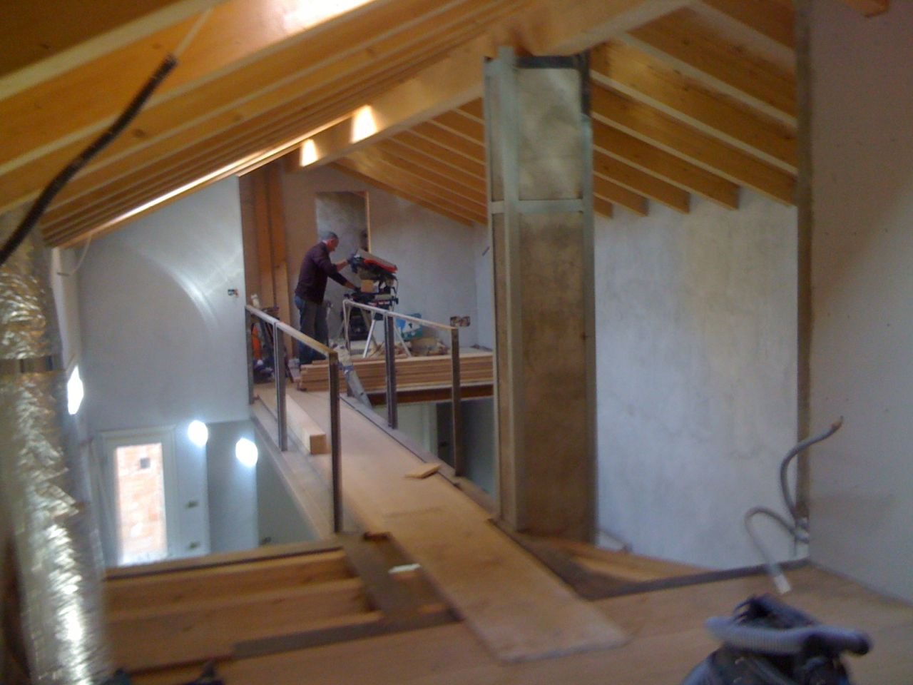 Erecting the walkway and the mezzanine floor for the attic bedrooms.
