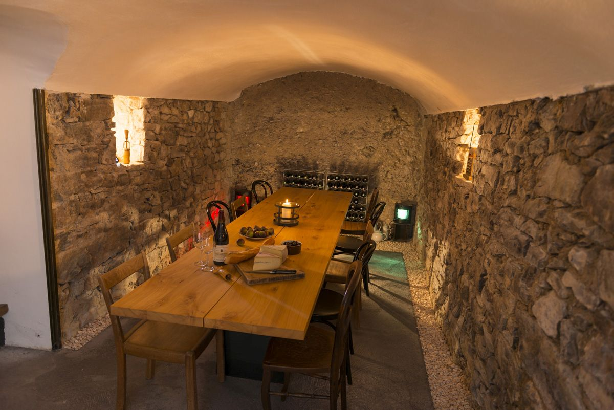 "The ""cantine"" built in the basement of the main part of the house. Lights which shine the whole room are fitted in lateral alcoves. To the left, a little staircase leads to the main living room."