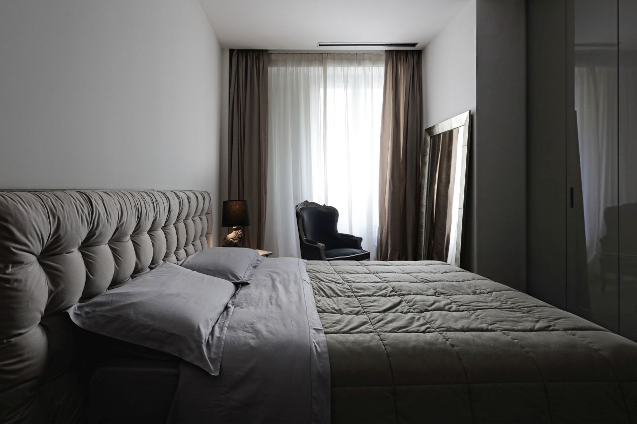 Sanya bed by Flou with tufted headboard and wardrobe New Entry by Poliform