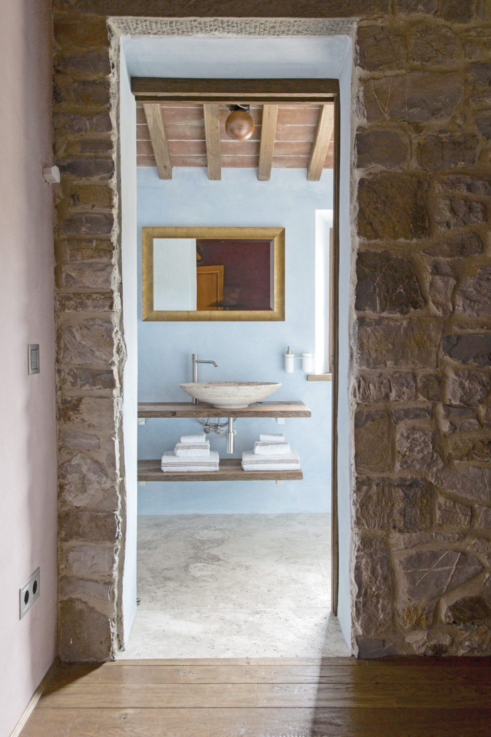 The delicate hues and modern design of the bathrooms in the farm