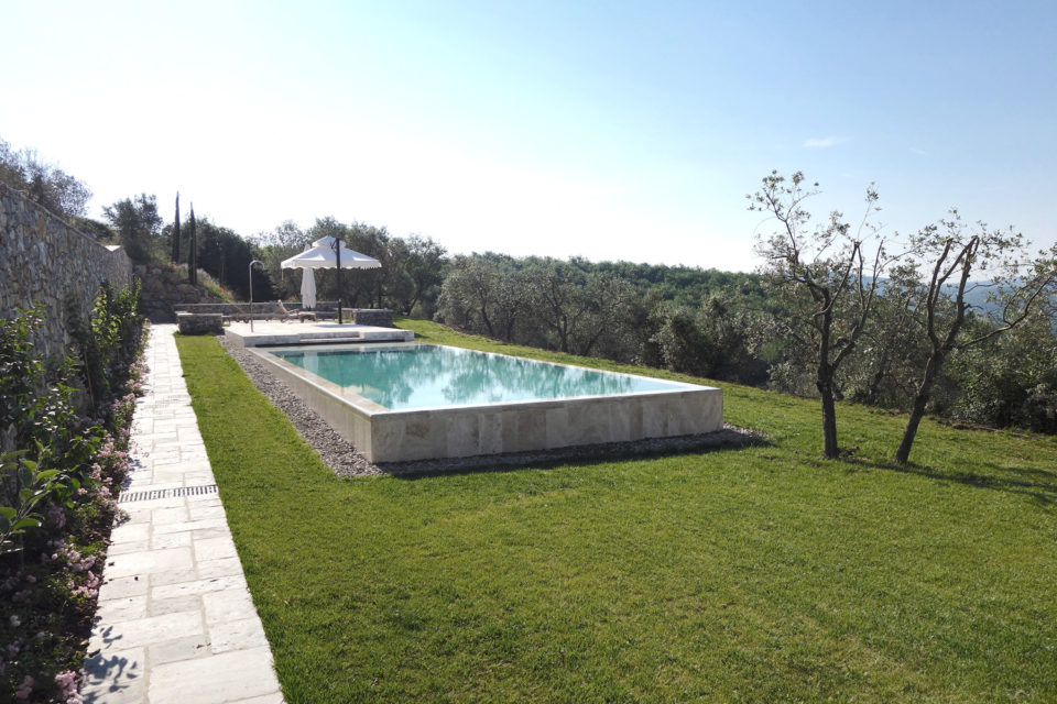 The swimming pool is an integral part of the surrounding landscape
