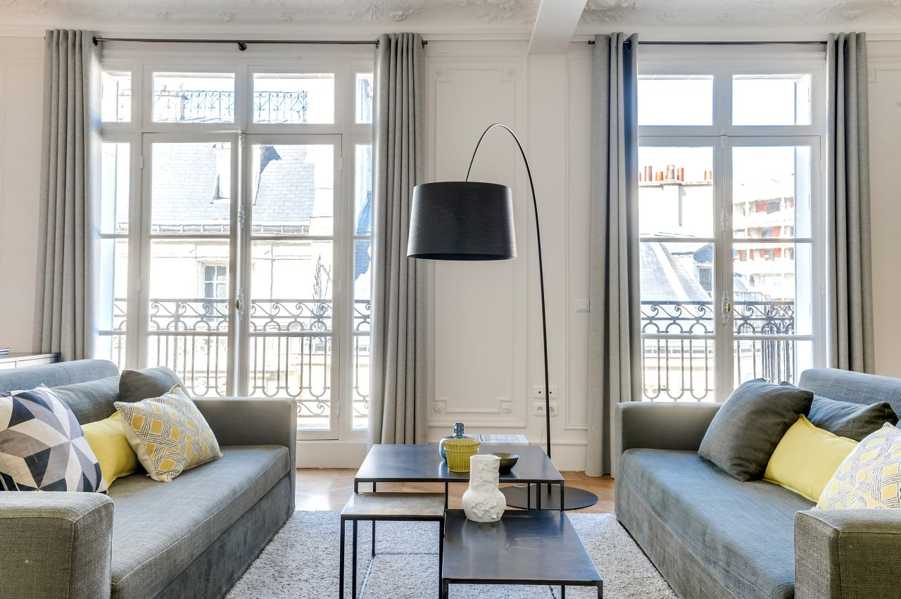 in the living room large windows and traditional French balconies. Twiggy floor lamp by Foscarini.