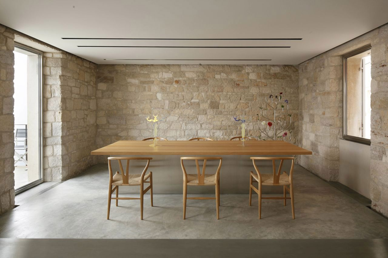 concrete screed flooring, timber-framed table and chairs CH 24 by Carl Hansen