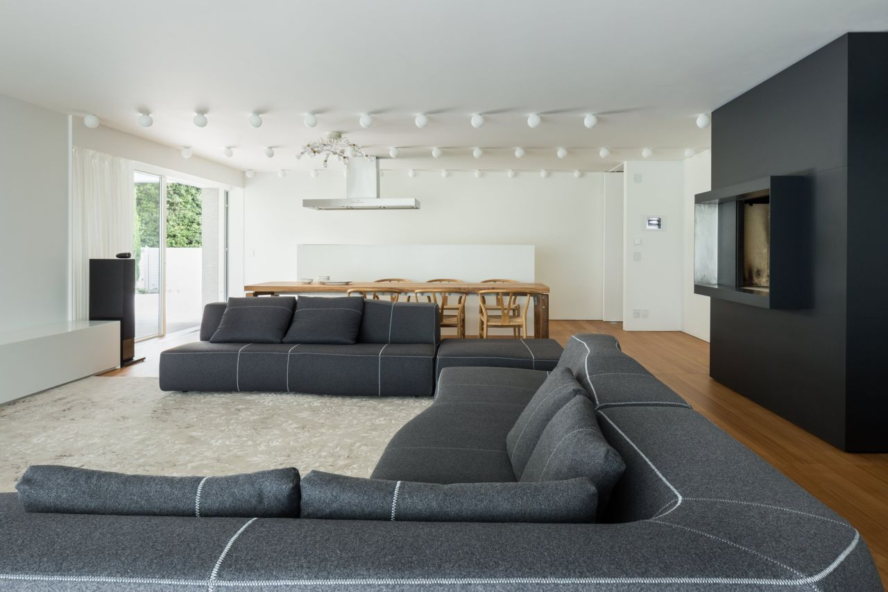 movie-room-style sofas by B&B Italia, and the fireplace for family barbecues