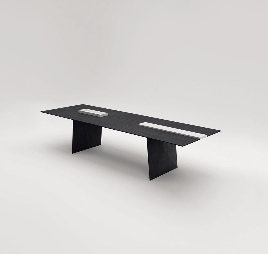 With its minimalist design and soft lines, Kanji is a table which can be accessoried in variuos ways: it is possible to replace the central element with a cutting board or storage units in vario...
